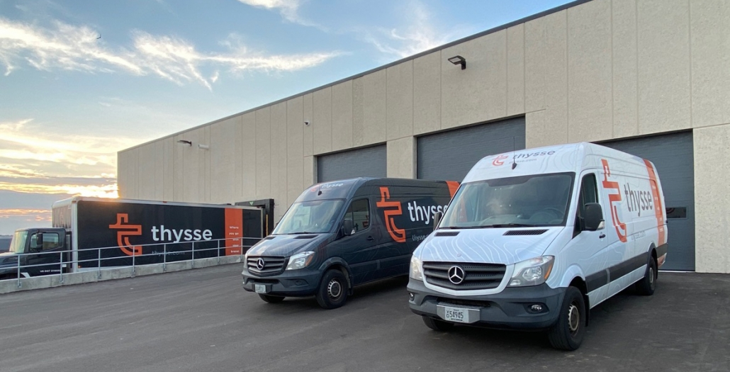 Fleet of Thysse delivery trucks at new campus