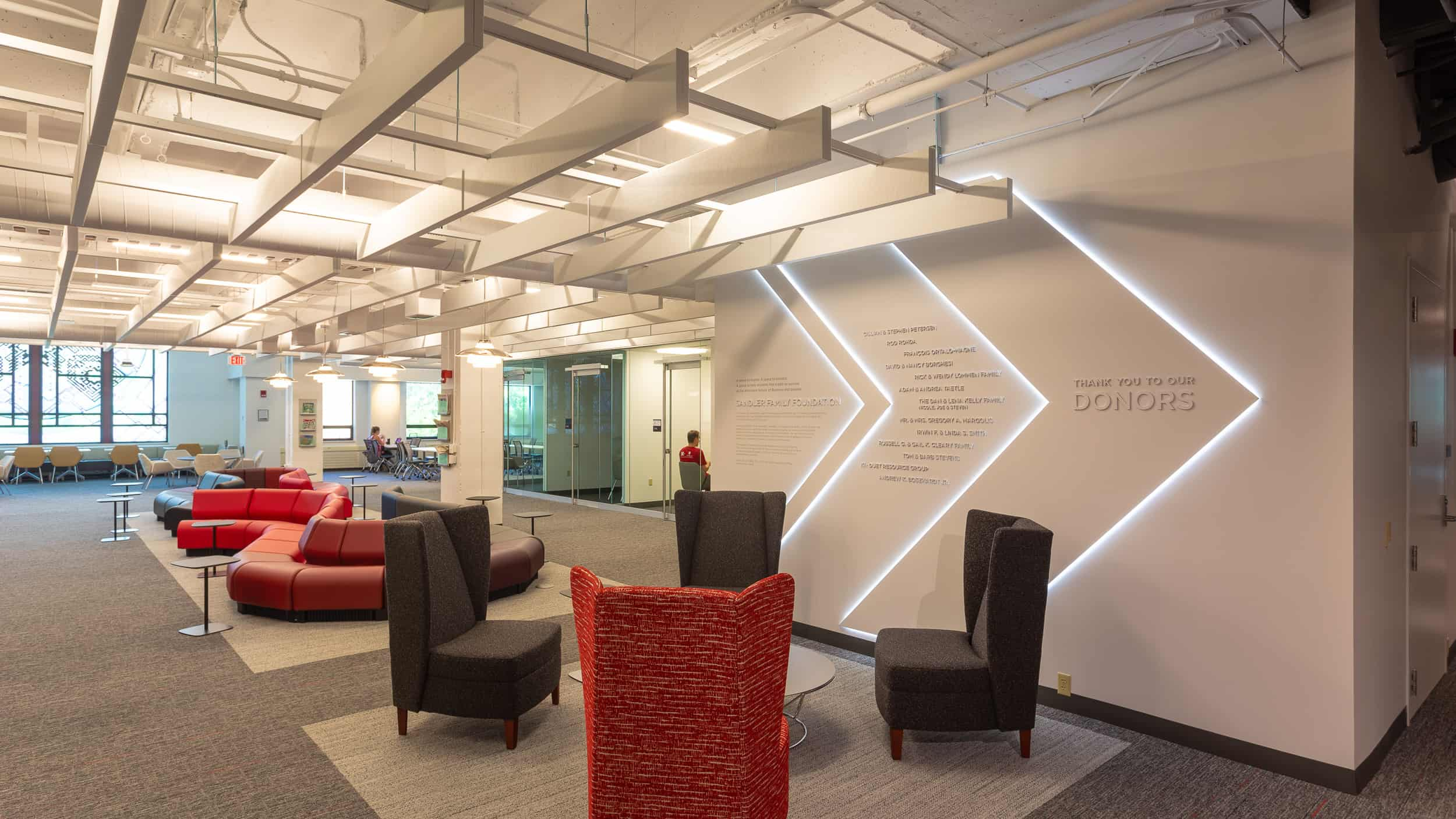 University of Wisconsin School of Business – Grainger Learning Commons. The Thysse experiential design team designed, fabricated and installed a custom LED-lit donor wall, custom branded privacy vinyl, dimensional metal letterforms